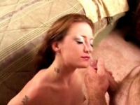Tattooed brunette chick caught in a cum-popping blowjob action.
