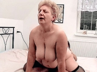 Mature blonde babe riding a huge cock in the bedroom