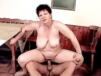 Short haired plumper riding a huge cock