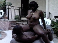 Ebony whore with huge hooters riding cock outside
