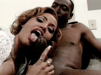 Black hottie licking huge hard dick