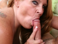 Mature blonde plumper filling her mouth with cock