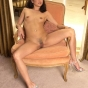 Slim Asian Lays Out Her Goodies On The Living Room