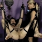 Mistress Nicolette Plays With Her Slave Who Is Bound And Hanging With A Gag On His Mouth