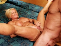 Busty milf Roxy smiles at the camera as she has her hot pussy fucked hard and rough