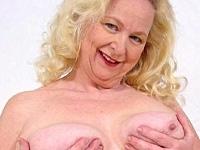 Older blonde plumper spreads her pink pussy