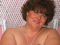 Plumper granny teases with her soft big tits