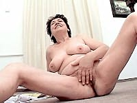 Mature whore playing with her chubby cunt near the stairs
