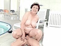 Older brunette filling her chubby cunt with cock