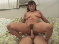 Dark-haired chubby nerd pumping on top of long meaty dick